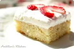 WHITE SHEET CAKE WITH CREAMY TOPPING AND STRAWBERRIES