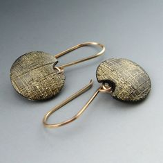 Modern etched polymer clay earring in gold and black on handmade french earwires via Etsy
