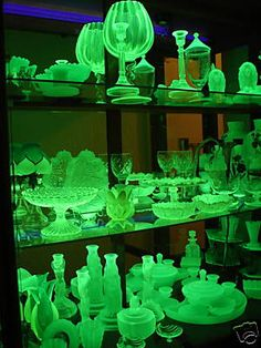 This is called vaseline glass. It's got uranium in it to give it a yellow colour and so it glows under black light. It's a collector's item but you can often find inexpensive pieces on ebay under vaseline or uranium depression glass. It is NOT amber glass though, it is a much lighter shade of yellow than the amber depression glass. Just in case anyone wants to collect some for halloween or a party.