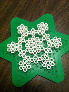 Perler Bead Christmas Patterns | ... peg board and some white beads and arranged them in the above pattern