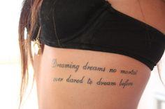 I kinda like this...and I usually hate rib tattoos