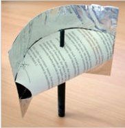A reflector made from tinfoil and some stiff paper cut out of junk mail. Will help boost your Router Signals,