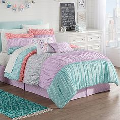 Add a touch of whimsy to your bedroom with the lively Zoe Reversible Comforter Set. Decked out in an array of dainty patterns and designs, the bright bedding is the perfect way to bring a fun and flirty look to any bedroom.