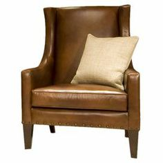 """Bring stately style to your living room or home office with this handsome leather chair, showcasing a wood frame and nailhead trim.      Product: Chair   Construction Material: Hardwood and top grain leather  Color: Rustic and dark brown  Features:     Nailhead accents along sides and base  Tight back cushion    Curved track arm        Dimensions: 47"""" H x 37"""" W x 35"""" D               Note:  Accent pillow not included"""