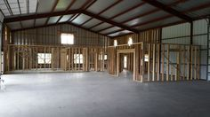 Wood framing the inside first floor Morton Building Homes, Steel Building Homes, Metal Shop Building, Building A House, Pole Barns, Pole Barn Garage, Pole Barn House Plans, Pole Barn Homes, Garage House