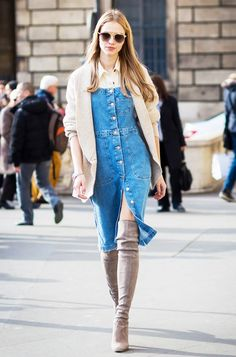 Layer your denim dress with a button-down, cardigan, and knee-high boots