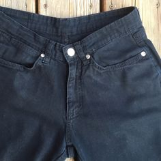 "WRANGLER Mid Rise Black Boot Cut Jeans 9"" Mid Rise Wrangler Black Boot Cut Jeans. 97% Cotton & 3% spandex. 31"" inseam. Last picture is not necessarily this particular jean, but is to illustrate fit only. (Picture from jeanscene.co.uk). Wrangler Jeans Boot Cut"