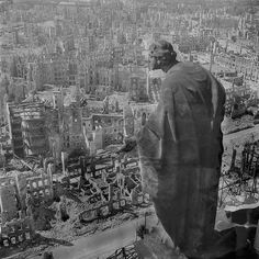 In this powerful and chilling photograph taken between Sept. 17 and Dec. 31 of 1945, we see a statue overlooking the recently bombed and destroyed city of Dresden, Germany. Photograph by Richard Peter.