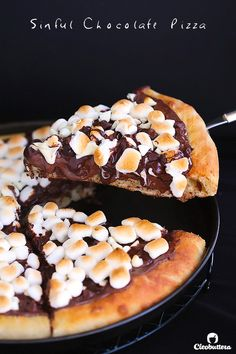 Soft pizza crust topped with Nutella, 3 types of chocolate and toasted marshmallows.  This dessert pizza is a chocolate lover's dream come true.