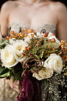 Burgundy Bouquet with a Metallic Gold Wedding Dress | Marcel and Meher Photography | http://heyweddinglady.com/warm-and-cozy-winter-wedding-with-a-little-holiday-sparkle/