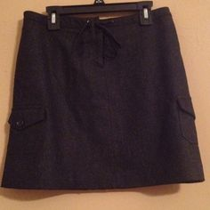J.Crew Wool Skirt Gray wool skirt with side pockets and drawstring. Very comfortable! Worn a couple times. Like new! J. Crew Skirts