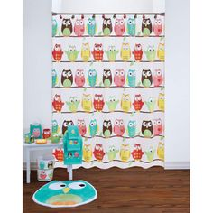 The Owl PEVA shower Curtain features rows of adorable owls sitting on a branch.