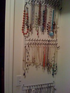 Necklace organizer my husband made with a 4 ft piece of shelving and tie holders from Home Depot. I hung it inside my closet