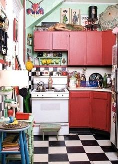 Busy red boho kitchen with black and white tiles