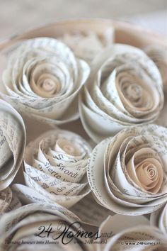 I have a big bag full of these paper roses I made for Becca's Wedding, April!