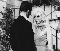 "Marilyn and Dean Martin filming a scene from ""Something's Got To Give"" 1962."