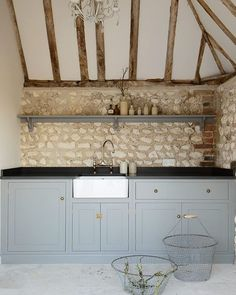 Beautiful deVOL furniture was used throughout this big family home in the South Downs and the family's Pool House was no exception... this simple run of Shaker cupboards painted in 'Lead' fitted in just perfectly. #deVOLKitchens