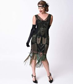 Ragtime, jazztime, or swing, the Dorsey Flapper will make you sing! An enchanting black mesh flapper dress available exclusively at Unique Vintage, The Dorsey is hand beaded in vibrantly ornate detail. A sleeveless, fitted silhouette is authentic to the r