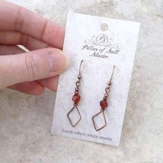 Handmade copper wire wrapped earrings. • Metal: solid copper, antiqued. • Stone: Red Carnelian • Dimensions: They hang approximately 1 7/8 from the piercing. • Because each pair is handmade, please expect minor differences from those in the photos. **CARE TIPS: To help your #wirejewelry