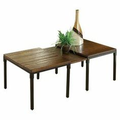 """Expandable hardwood coffee table with a dark chestnut finish.   Product: Coffee tableConstruction Material: WoodColor: Dark chestnutFeatures: Extendable leafDimensions: 18"""" H x 44-60'' W x 26"""" D"""