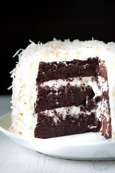 Chocolate Cake with Coconut Cream Filling and Marshmallow Buttercream Frosting - the perfect cake recipe for birthdays, holidays, parties and more! #chocolate #cake #recipe