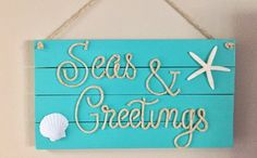 This beachy piece of art is made from reclaimed wood and would be perfect for a nautical inspired beach house to welcome your guests! Each sign is hand cut, hand sanded and hand painted. Each sign is made to order so no two will be exactly alike due to variations in the wood. Dimensions are 26x 14 inches.