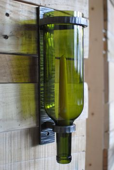 Wine Bottle Sconce. Hand-forged Candle Holder I SEE WINE BOTTLE LAMPS BUT THIS IS DIFFERENT. I WILL THINK ABOUT IT.