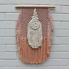 """Strong but gentle, simple yet intricate.. Our """"Amari"""" wall hanging is completely hand-made with hand-dyed peach & musk tones and a natural rope coiled center piece. There's only one available so this little gem will surely be a unique and stunning feature in your home. Online now (link to website is in our bio)"""