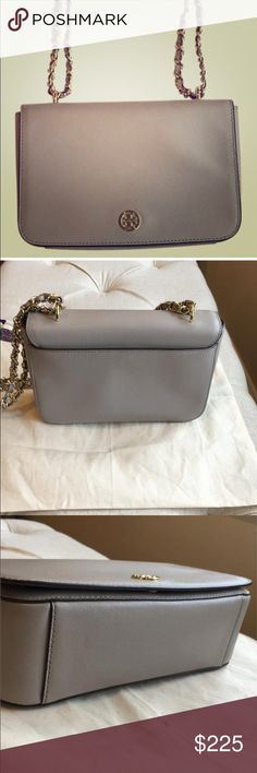 Tory Burch Handbag Grey textured crossbody purse with gold toned hardware. Two chain shoulder strap can convert to single strap crossbody. Magnetic closure in front. Magnetic closure for back compartment. Zip compartment on inside and phone/small wallet compartment on inside as well. Dust bag included. Tory Burch Bags Crossbody Bags