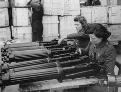 Women in the ordnance depot in England check a new shipment of Vickers machine gun that just arrived from the United States as part of Lend Lease, 1940