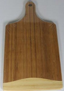 """Bamboo Cutting Board - 18""""x10"""" by Vanderbilt Home. $27.99. Paddle shape makes this board ideal for serving. 18""""x10"""". Solid Bamboo construction promises long lasting quality. Deep channels trap juices keeping your countertop clean. Large size provides plenty of space for carving & chopping. The bamboo cutting board with handle is not only convenient but also eco-friendly."""