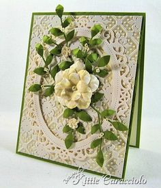 realistic flower graces the front of this lovely card...