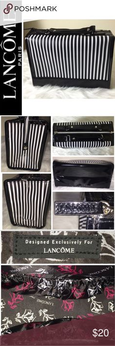 """NWOT Lancôme Signature Travel Cosmetic Bag NWOT Lancôme Signature Travel Cosmetic Bag, Beautiful Black and White Striped with Black Trim and Silver Hardware, Zip Top Closure with Snap End, 2 Interior Expandable Slip Side Pockets, Fully Lined Satin with Lancôme Imprint Design, Approx. size 10""""x 6 3/4""""x 4 1/2"""", NWOT Lancome Bags Cosmetic Bags & Cases"""