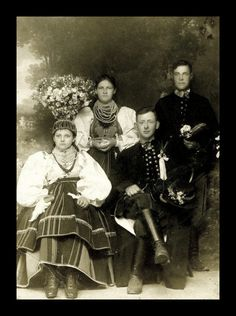 "Folk costume from Łowicz, Poland - bride in traditional ""flower crown"" on the left. Archival photograph (date unknown)."