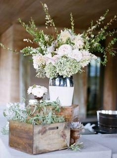 Photography: Sylvie Gil; Wedding reception centerpiece idea