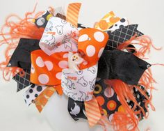 Ghostly Explosion...Sassy Halloween Over the Top Hair Bow...and matching Headband. $19.99, via Etsy.