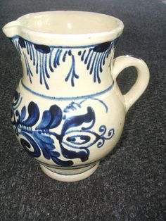 "Vintage 1950 Majolica Art Pottery Pitcher.  This beautiful hand painted pitcher is Cream in Color with a rich Cobalt Blue Delft design.  It measures 7 1/2"" Tall, 4 1/2"" Wide at the pitchers opening and has a 3 1/4"" Base Diameter. ~ $40.00"