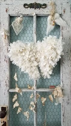 Creamy White Tattered Angel Wings These fluffy little angel wings are made from tattered and torn strips of abandoned vintage cream and white fabrics that will bring a soft romance to any room they fly to! A hand formed wire base was made into pretty little wings, painted a creamy white with all the edges wrapped in tattered and torn strips of fabric. Each piece of wire is lovingly covered in hundreds of tied strips of fabric so no piece of wire is showing, to create gorgeous feathery wings…