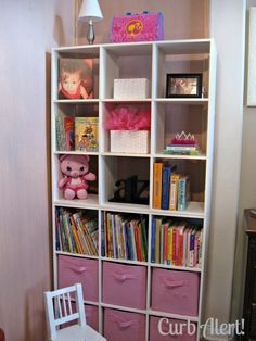 Furniture:The White Floor To Ceiling Cube Wall Shelves Ikea Ideas With The Soft Flesh Pink Box Organizers In The Lower Part Of Shelves And The Colorful Kids Book Collections Comfy Interior with Cube Wall IKEA Shelf for Neat Storage