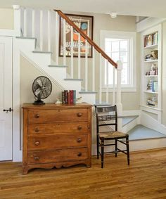 farmhouse whole house remodel living room with kite staircase, built-in bookshelves
