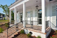 New Orleans Charm with a Private Courtyard - Traditional - Porch - new orleans - by Highland Homes, Inc. Wrought Iron Porch Railings, Front Porch Railings, Brick Porch, Front Porch Steps, Front Porch With Columns, Porch Banister, House Columns, Front Deck, Front Entry