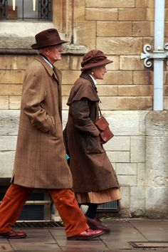 Very dapper looking couple walking along Oxford Street - love their style!