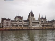 The impressive apparition of the building of the Parliament, viewed from a boat touring the Danube.