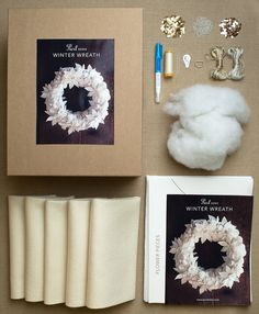 Winter Wreath Kit from Purl Soho: Made in 100% wool felt and trimmed with embroidery and sequins, our Winter Wreath is the perfect complement to the snow-covered season. And since it's all hand sewn, you don't need a degree in handcraft engineering to make your wreath as beautiful ours! Each Winter Wreath Kit includes all the supplies you'll need to make one 16-inch wreath: 5 pieces of 18 x 18 inch wool felt in ecru, interfacing, cotton thread, metallic embroidery floss in silver and white ....