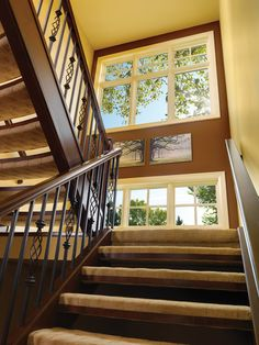 Stacked fixed sash trios with simulated divided lites combine to create a striking look.