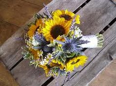 blue thistle and sunflower bouquet