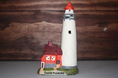 $8.00 USD on Etsy. Porcelain Tawas Point, MI lighthouse