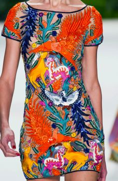 i want this, its just so crazy and wild and great.   beading, embroidery and bright colors on this sheer #naeemkhan minidress.
