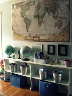 I have a thing for maps, I actually have this same world map at my house. I think it's the multipurpose of them that I'm drawn to, they are both artful and informative. This is a great geography learning station that can be appropriate for many ages, depending on what resources and materials line the shelves.