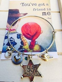 Toy story friendship bracelet, Themed Bangle Bracelet, Adult size, woody, buzz light year, jewelry, disney toy story Themed Bracelet by FairytaleBangles on Etsy https://www.etsy.com/listing/469842266/toy-story-friendship-bracelet-themed